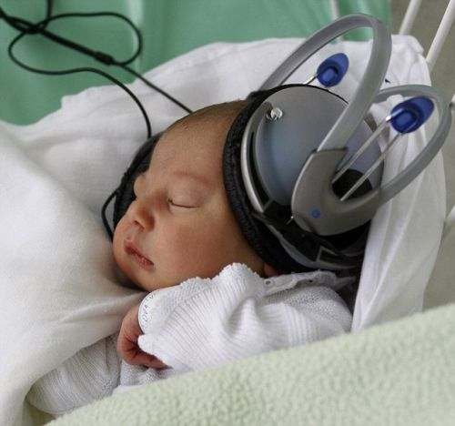 Newborn Bruno listens to music through headphones at the Saca hospital in Kosice, Slovakia, Tuesday, May 10, 2011. The hospital uses music therapy to help newborn babies that have to be separated from theirs moms for treatment. (AP Photo/Petr David Josek)